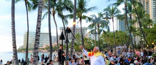 Torch lighting ceremony before hula show starts at Kuhio Beach in Waikiki.