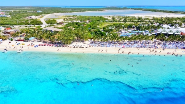 Beach near Grand Turk cruise port. What to wear on cruise excursions: Best travel bags, backpacks, and travel shoes/sandals for port day. Caribbean cruise.