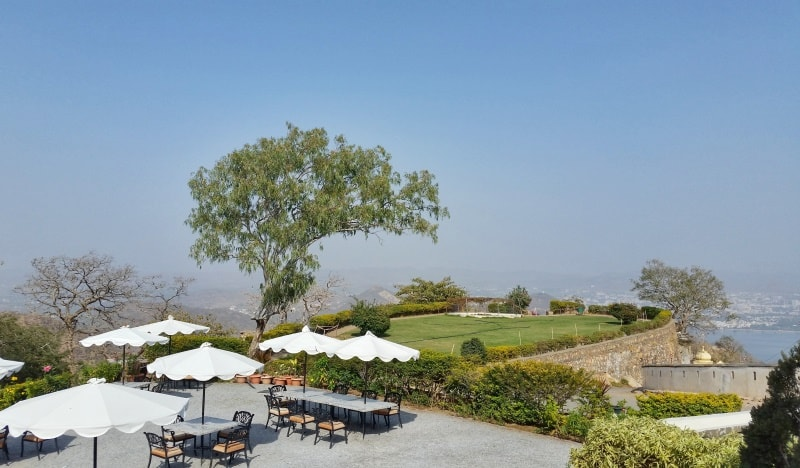 Udaipur itinerary, 3 days: Monsoon Palace cafe restaurant hilltop with best sunset views of Udaipur. Best places to visit in Udaipur, Rajasthan, India.