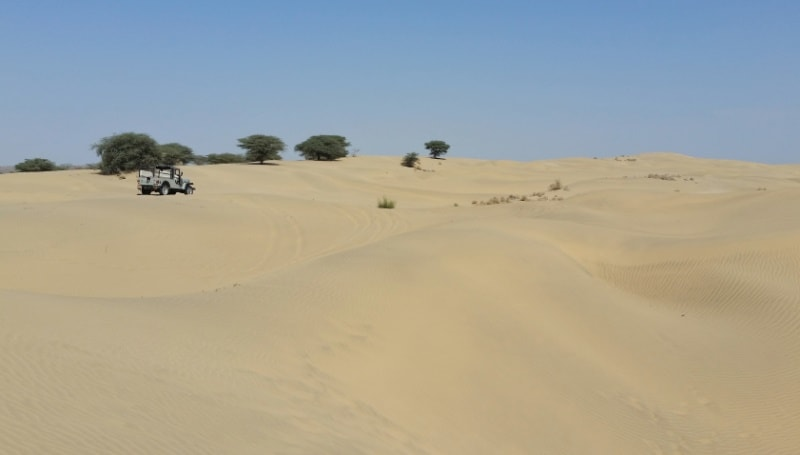 Jaisalmer itinerary, 5 days, one week: Jaisalmer to Khuri sand dunes by bus, Khuri jeep safari. Best places to visit in Jaisalmer, Rajasthan, India.